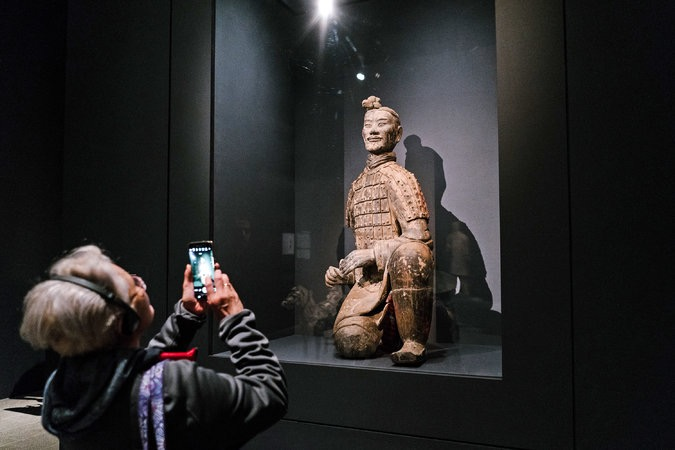 """Kneeling Archer,"" an earthenware sculpture from the Qin dynasty. Photo: Jake Naughton for The New York Times"